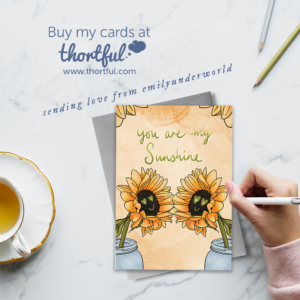 "Emily Underworld Greetings Cards Ad featuring sunflower card and quote ""you are my sunshine""."